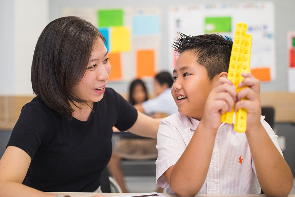 young student working with manipulative
